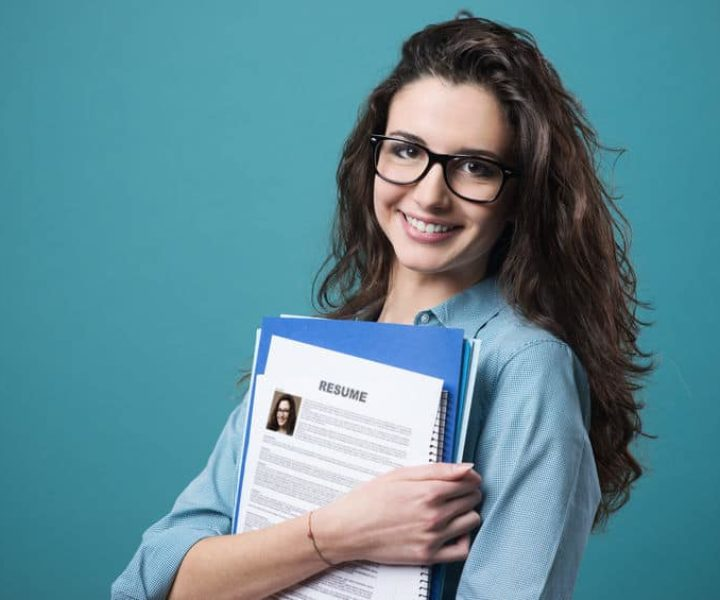 37461669 - young smiling cheerful woman holding her resume